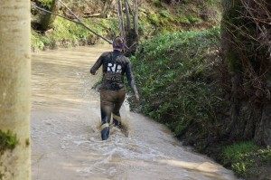 Wading through a cold stream  (picture courtesy of Tim Lovett from Obstacle Kit Ltd)