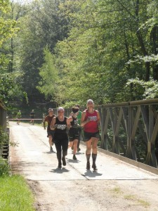 Myself, Tania and Lucy powering over the bridge and towards the finish