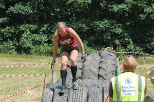 Clambering over the tires near the finish line