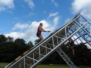 Climbing up the side of the final obstacle