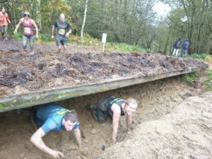 Cheeky grin as I crawl through the mud