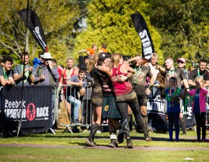 Linda and I in a finish line hug with MC Mark. Picture courtesy of Tom Nash