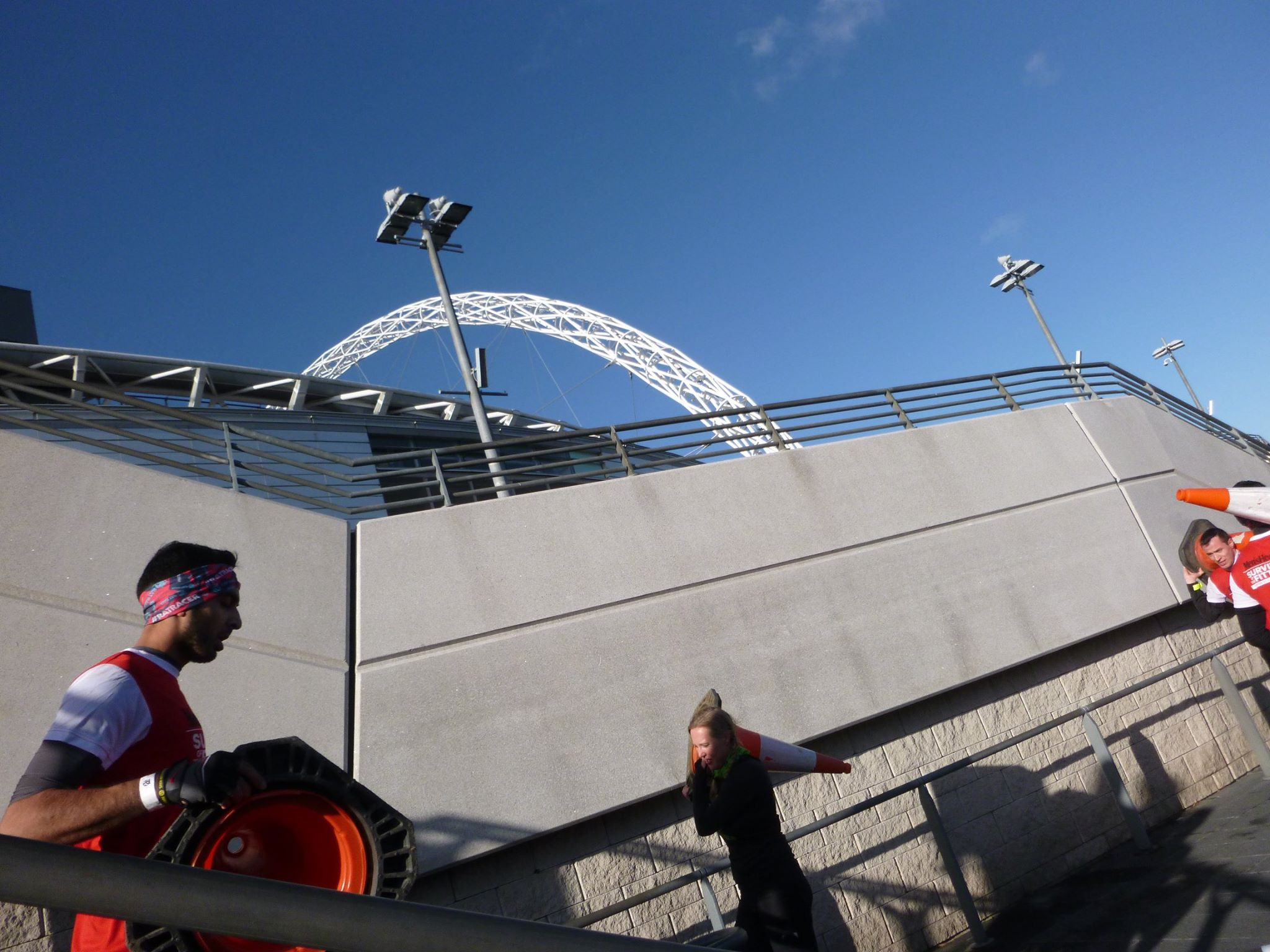 Carrying a cone with the Wembley arch in the background